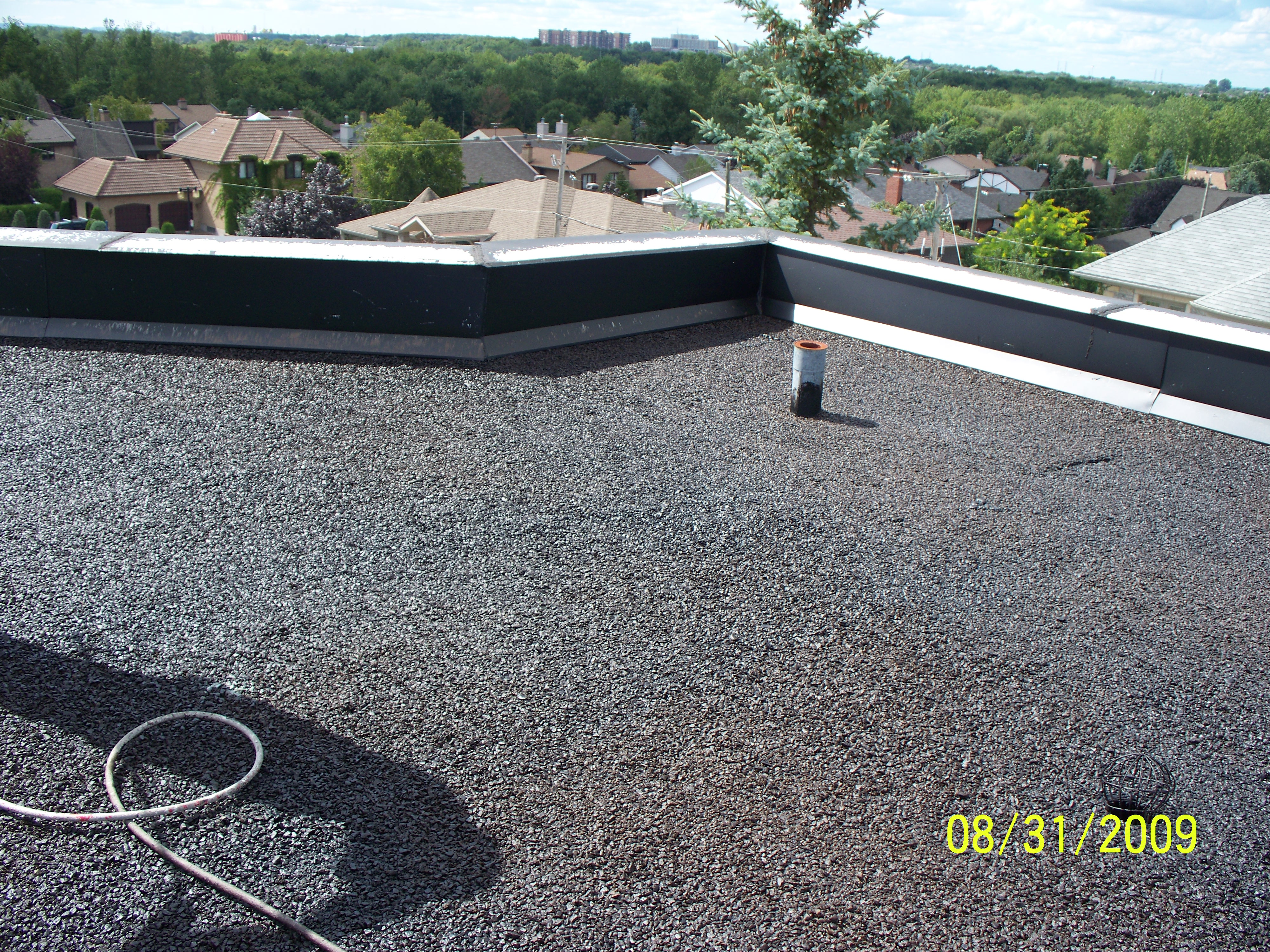 Liquid Rubber Roof Coatings/Commercial Grade - Mario Cinelli Hoouse Montreal Sptember 2009